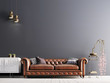 canvas print picture - empty wall in classical style interior with leather sofa on grey background wall.