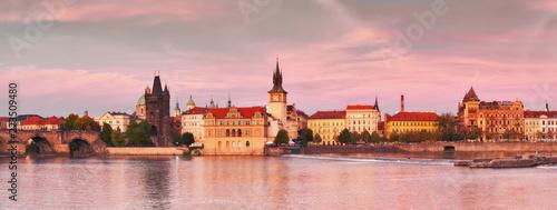Poster Praag Prague, riverside on sunset in a pink glow