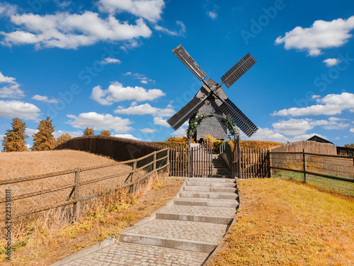 Photo  Historical windmill in Marzahn, Eastern Berlin, Germany, on a bright day