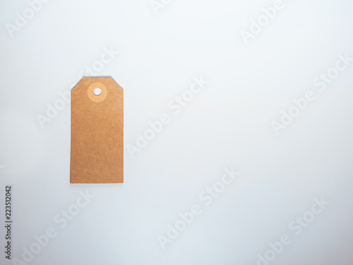 Isolated real vitange tag in white background. Space for text. Concept top view