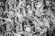 Sculpture Of Hundreds Outreaching Hands.  White Temple, Chiang Rai Thailand