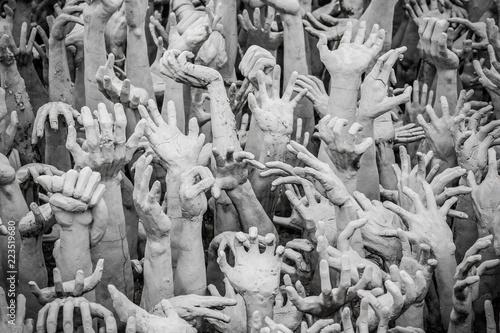 Photo  Sculpture of hundreds outreaching hands