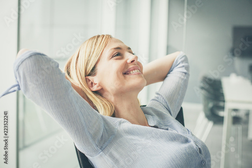 Poster Relaxation Business woman sitting on chair and relaxing.
