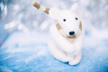 Holidays, Winter And Celebration Concept - Christmas And New Year Card With Toy Polar Bear. Blurred Background.