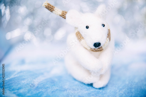 Staande foto Ijsbeer Holidays, winter and celebration concept - Christmas and new year card with toy polar bear. Blurred background.