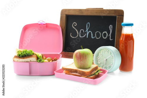 Appetizing food in lunch box and small chalkboard with word SCHOOL on white back Tapéta, Fotótapéta