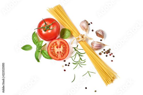 Spaghetti with tomatoes garlic and basil isolated on white background Fototapeta