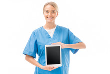 Smiling Young Nurse Holding Tablet With Blank Screen Isolated On White