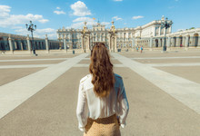 Stylish Traveller Woman Near Royal Palace In Madrid, Spain