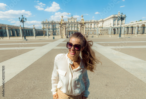 Fototapeta happy modern tourist woman near Royal Palace in Madrid, Spain obraz