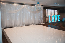 Wedding Dance Floor And Big Blue Illuminated Love Letters On A Wedding Day