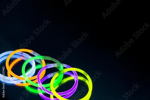 Colorful fluorescent light neon glow stick bracelet strap wristband on mirror re Wallpaper Mural