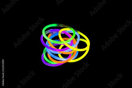 Valokuvatapetti Colorful fluorescent light neon glow stick bracelet strap wristband on mirror re