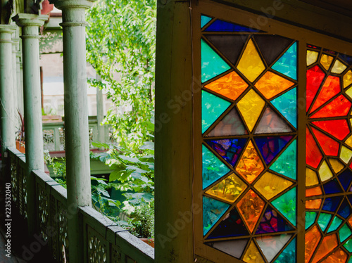 Foto op Canvas Bloemen Dreamy colors of stained glass in an old residential house in Tbilisi, Georgia. Perspective view of corridor and balcony