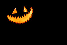 Scary Traditional Smiley Pumpkin Lantern On Black. Halloween Holiday Background