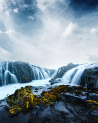 Famous Bruarfoss waterfall with blue water in summer time. Iceland, Europe