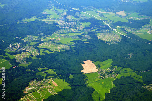 Papiers peints Bleu vert view from height to plain covered with forest