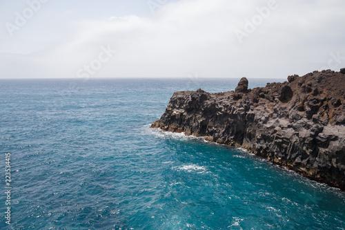 Rocky area formed by lava called Los Hervideros in Lanzarote, Canary Islands, Spain.