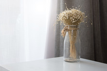 Dry Flower In Transparent Glass Vase Bottle At Living Room. Decoration And Interior Concept.