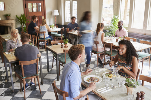 Fotografie, Obraz  Customers Enjoying Meals In Busy Restaurant