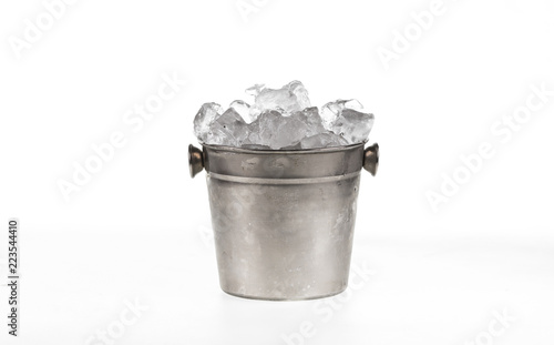 bucket with ice cubes for cooling on white background