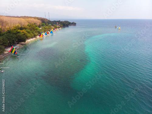Colorful of sailboat  on the beach at Jimbarab bay Indonesia