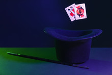 Black Hat, Magic Wand And Cards On Dark Background