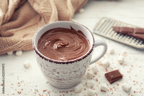 Foto op Plexiglas Chocolade Cup of hot chocolate on light table