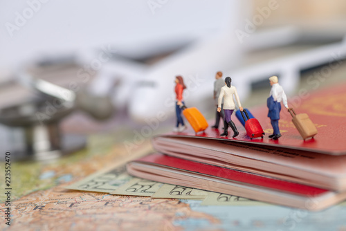 Obraz Miniature passenger concept of people travel to foreign land - insurance or medical tourism concept. - fototapety do salonu