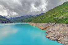 Beautiful View Of Reservoir Lake Moiry (lac De Moiry) With Vibrant Turquoise Blue Water At A Low Level In Summer In Valais, Switzerland
