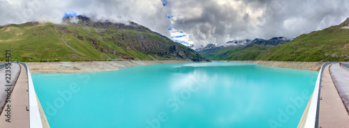 Staande foto Turkoois Beautiful 180 degree panoramic view of reservoir lake Moiry (lac de Moiry) with vibrant turquoise blue water at a low level in summer in Valais, Switzerland