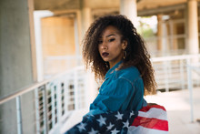 Young Woman Holding Flag Of America