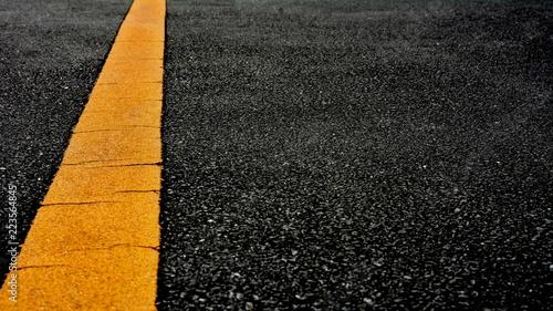 Yellow paint line on black asphalt  space transportation