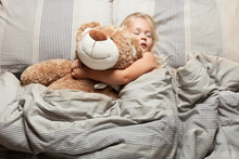 Baby Girl Sleep In Bed, Toddler Dream. Child With Teddy Bear. Comfort Home Relax.