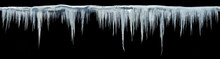 Icicles On An Black Background, Isolated Object. Panoramic Photo.