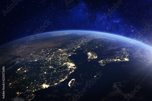 Photo  Asia at night from space with city lights showing human activity in China, Japan
