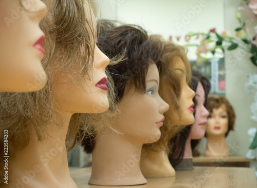 Wigs on the heads of mannequins