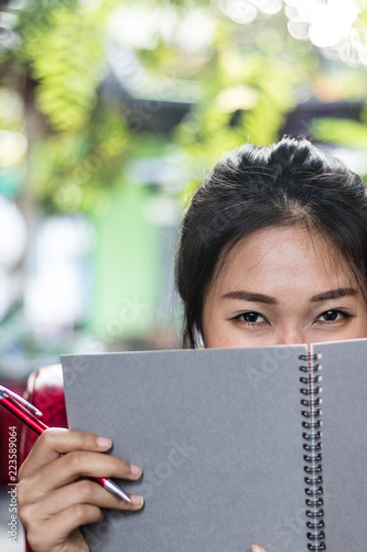 Fotografija  Asian women writing diary in notebook.