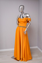 Evening Orange Dress On Silver Mannequin