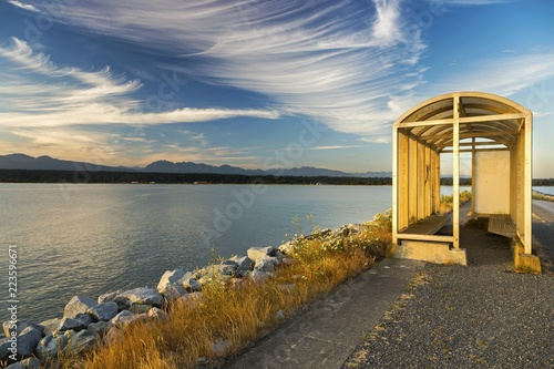 Valokuvatapetti Wind Storm Shelter on Walking Path on Iona Jetty Pier with distant view of UBC,