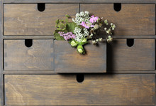 Flowers In Drawer Of Wooden Cabinet