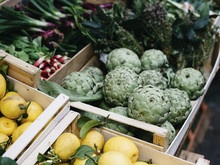 High Angle View Of Fresh Fruits And Vegetables In Boxes For Sale At Market Stall