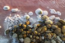 High Angle View Of Pebbles On ...