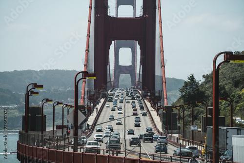 Vehicles moving on Golden Gate Bridge over sea against sky