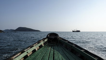 Wooden Boat Sailing In Sea Against Clear Sky