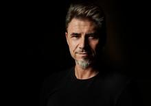 Portrait Of An Older White Guy Dark Background