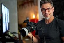 Older Man Holding Photo Camera Smiling