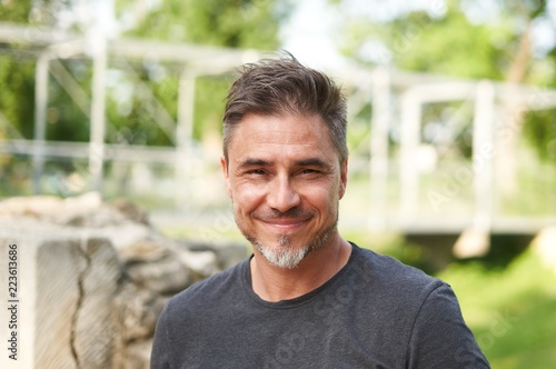 Obraz Outdoor portrait of happy older white man - fototapety do salonu