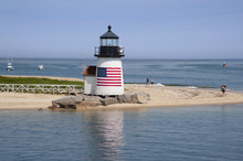 Nantucket Island Lighthouse With American Flag On Quiet Summer Day