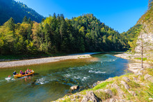Raft With Tourist On Dunajec River In Autumn Landscape Of Pieniny Mountains, Poland